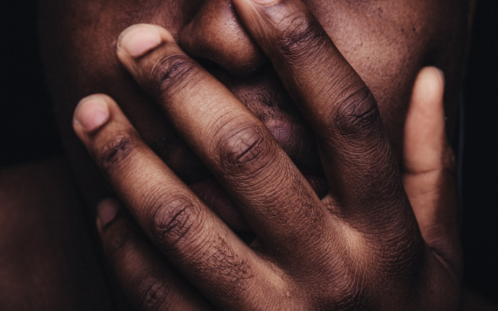 persons hand on face