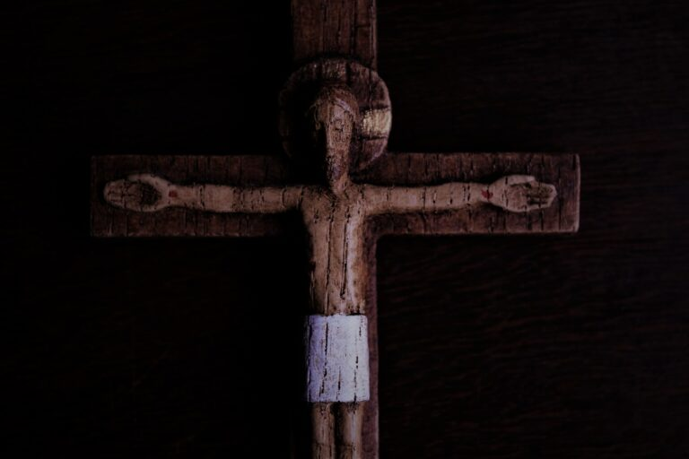 brown wooden cross with white cross